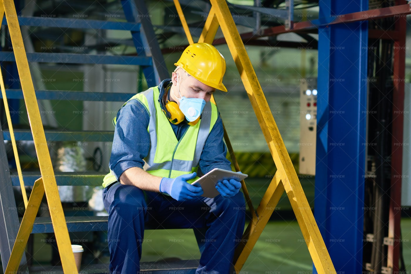 Plant Worker Using Digital Tablet: Stock Photos