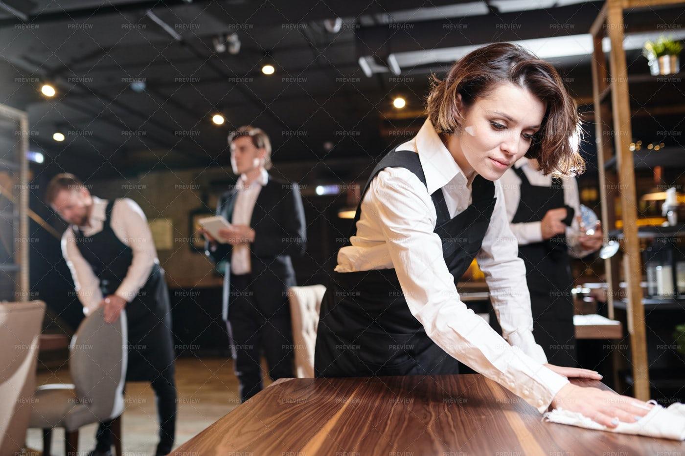Busy Waitress Preparing Restaurant...: Stock Photos