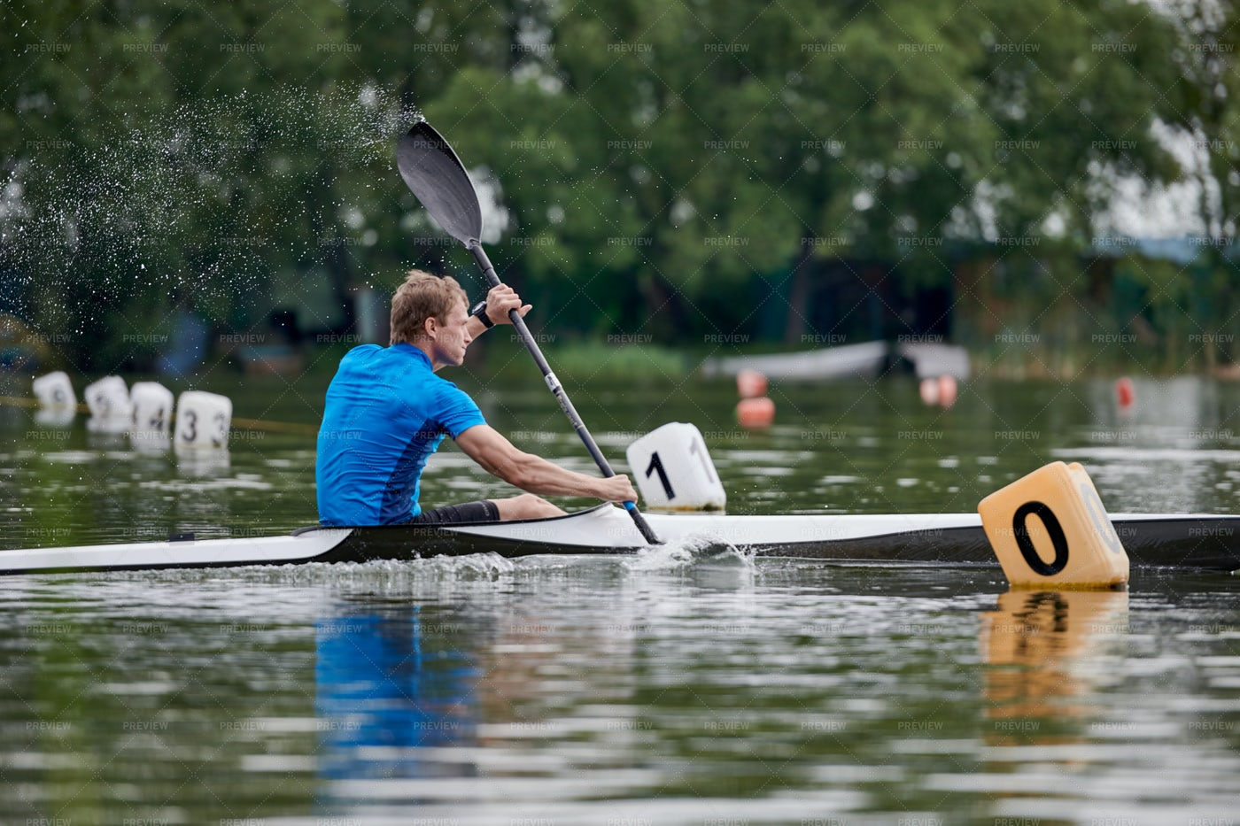 Paddler Racing On The Lake: Stock Photos