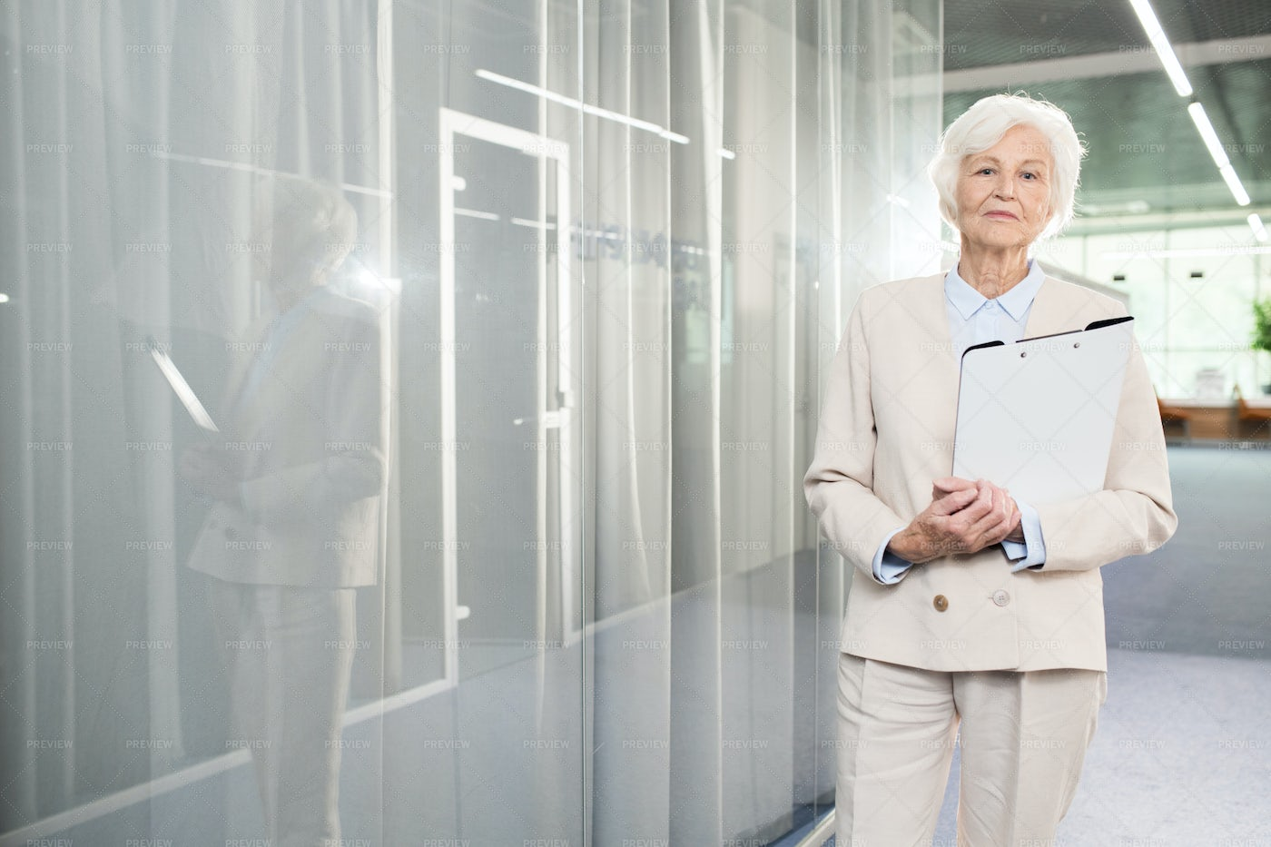 Confident Senior Business Lady With...: Stock Photos