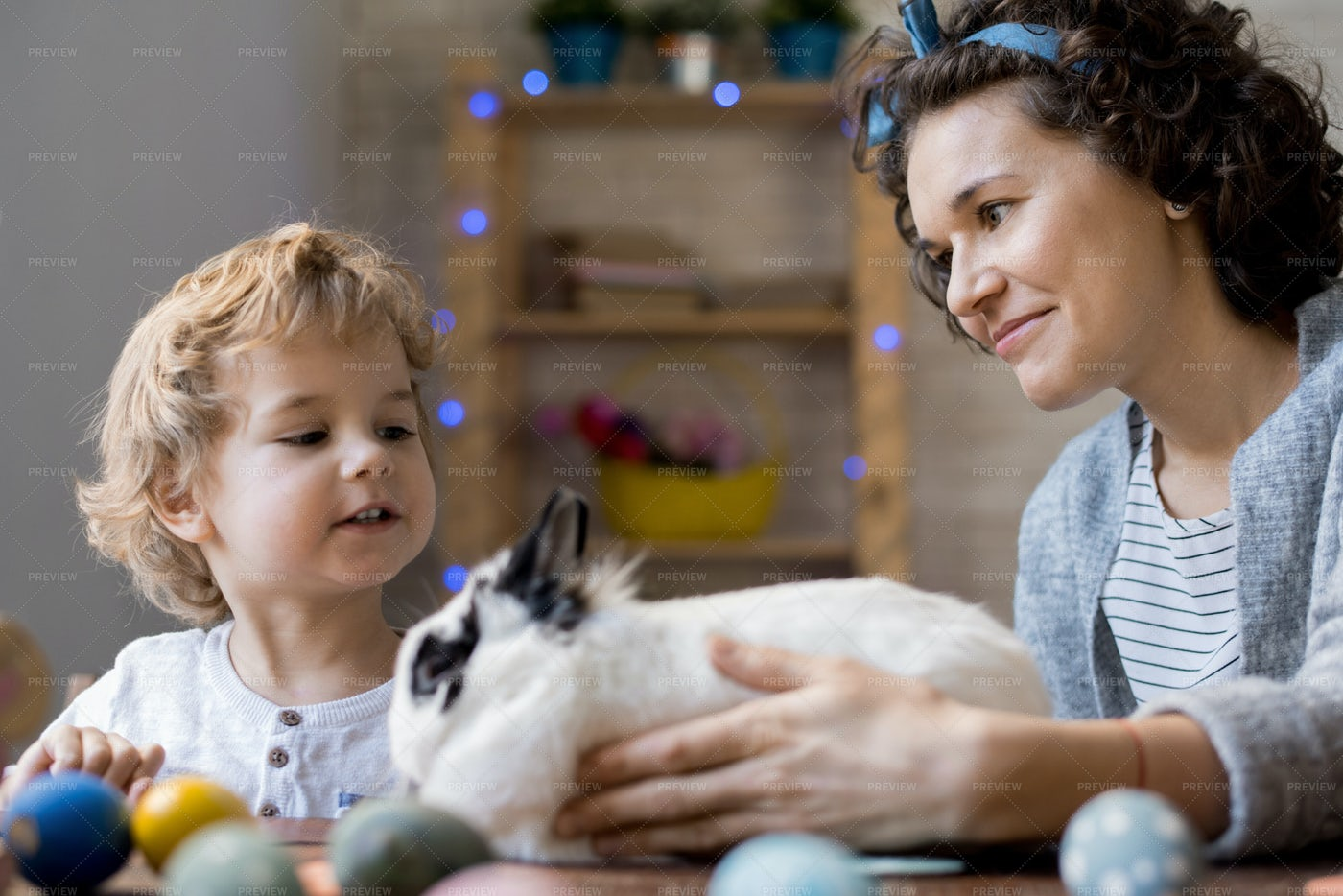 Mother Giving Easter Bunny To Son: Stock Photos