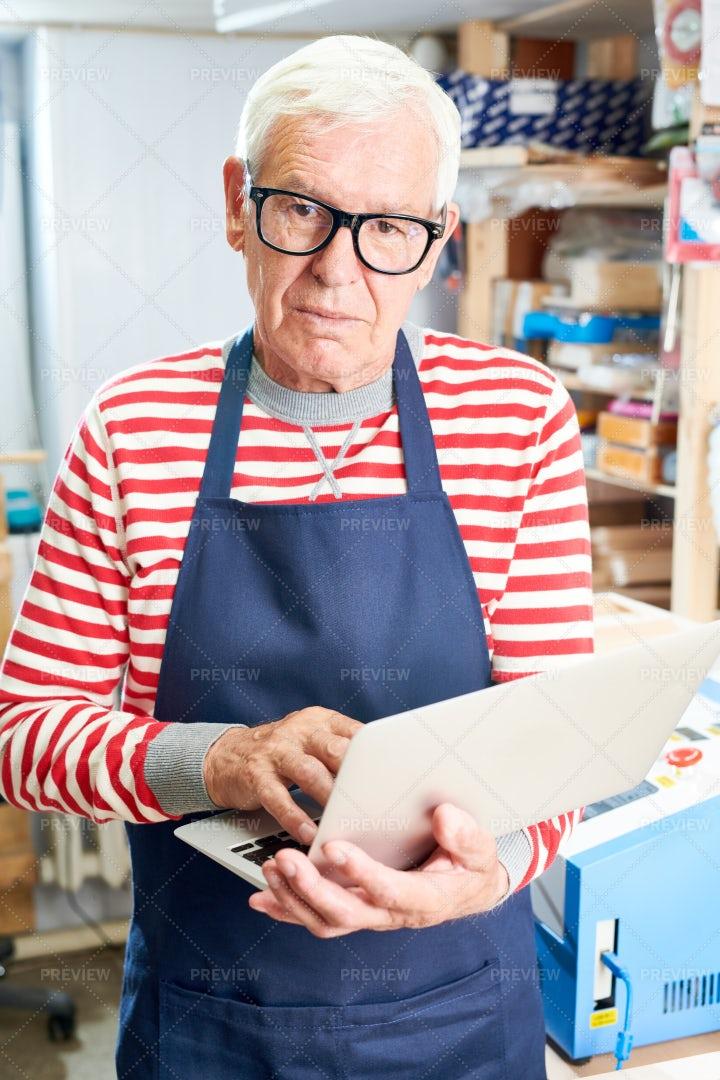 Senior Craftsman Browsing Modern...: Stock Photos