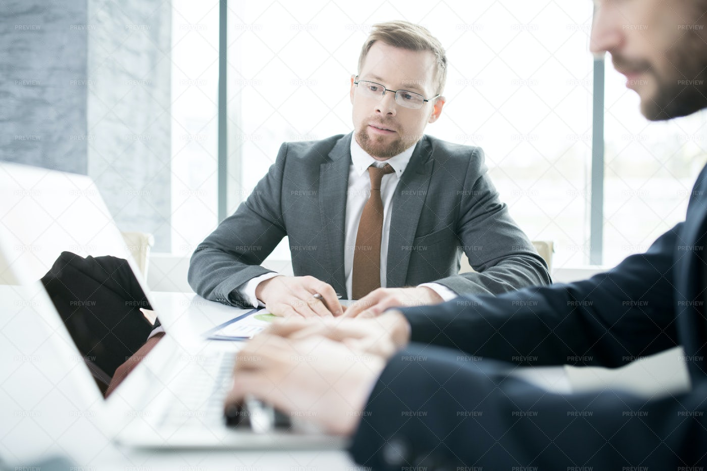Two Business People Using Laptop: Stock Photos