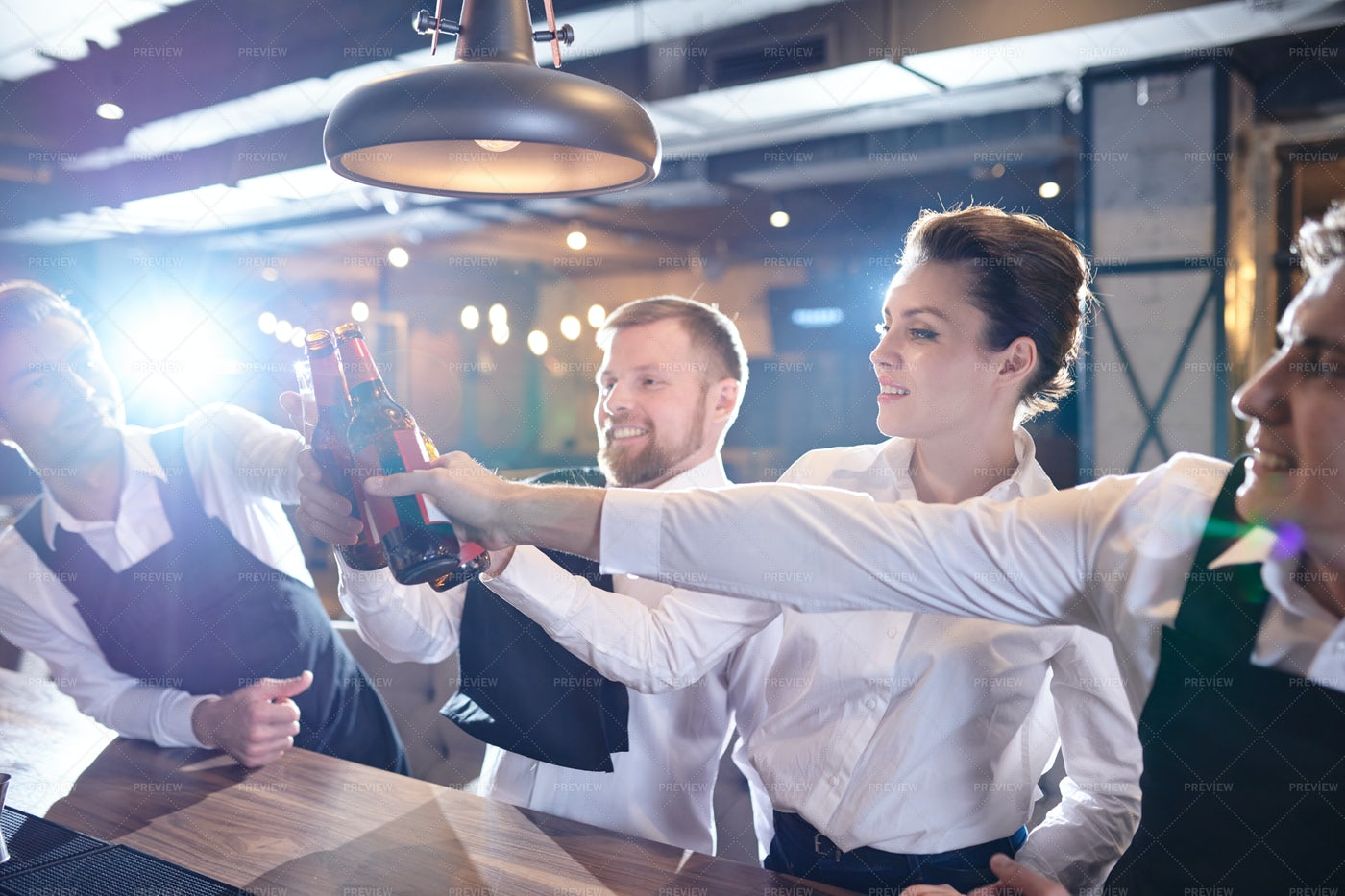 Excited Waiting Staff Drinking For...: Stock Photos