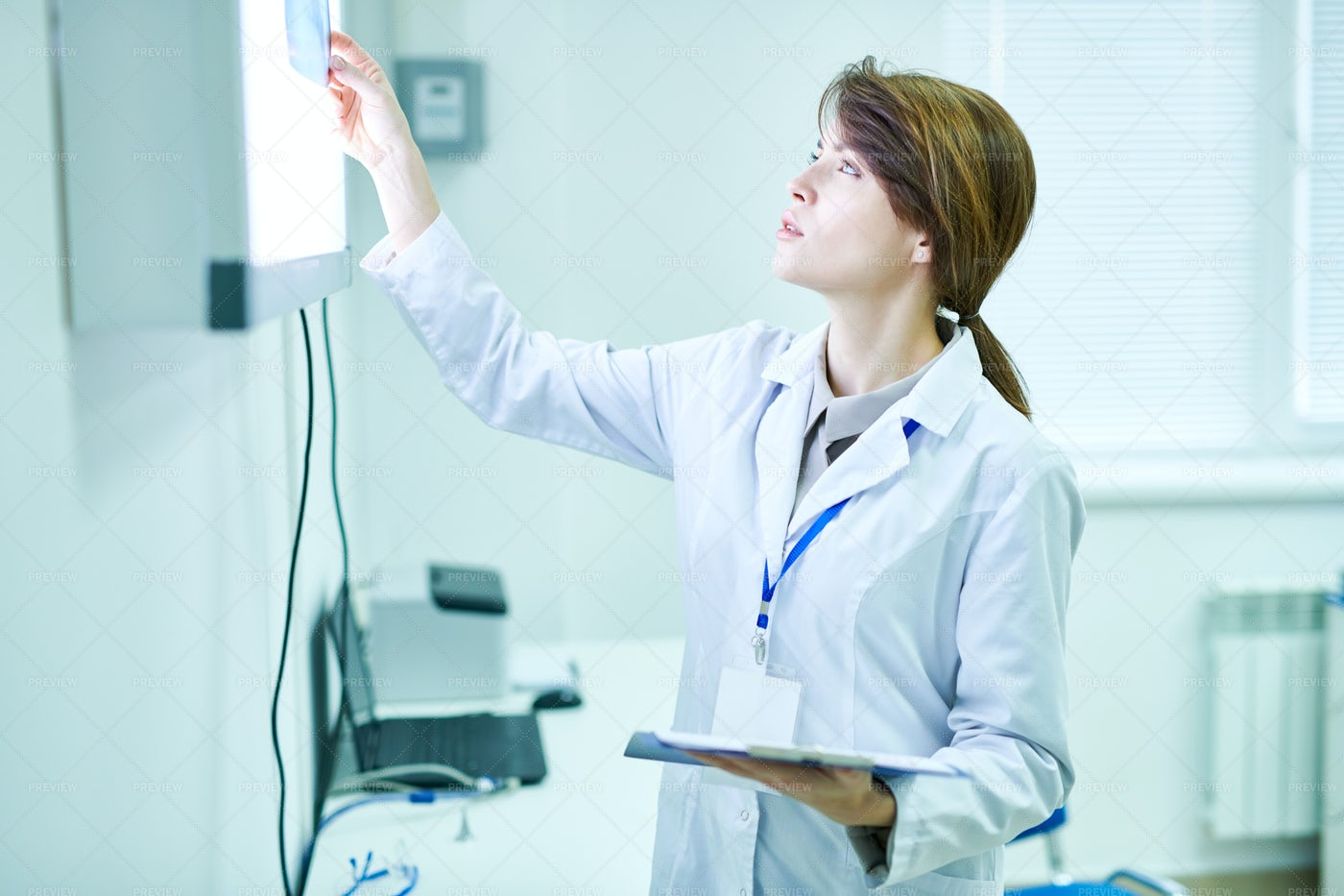Doctor Standing And Looking At...: Stock Photos