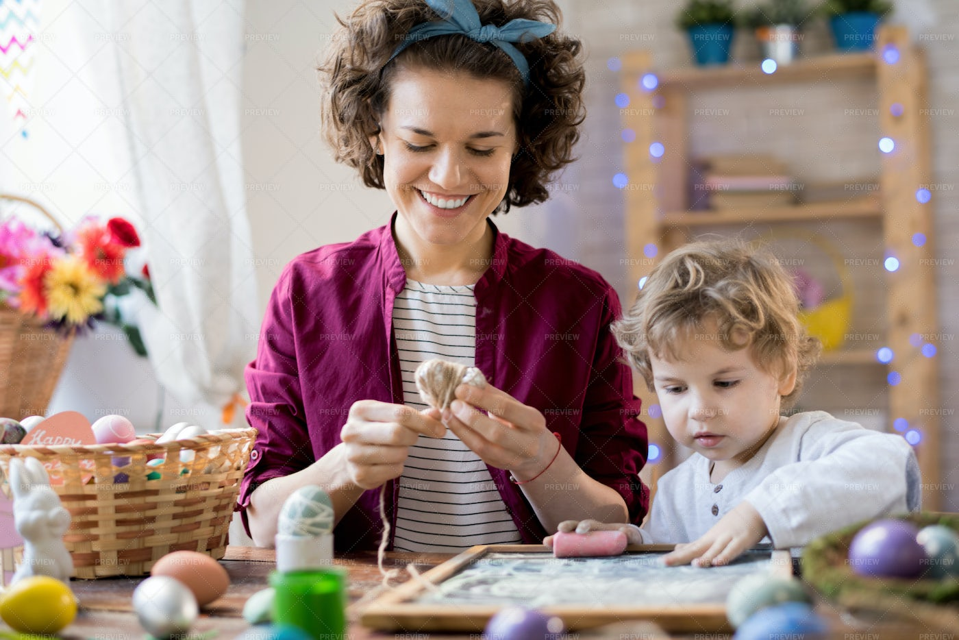 Young Mother Making Easter...: Stock Photos
