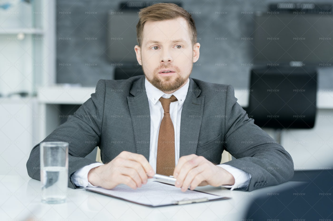 Young Businessman Listening To...: Stock Photos