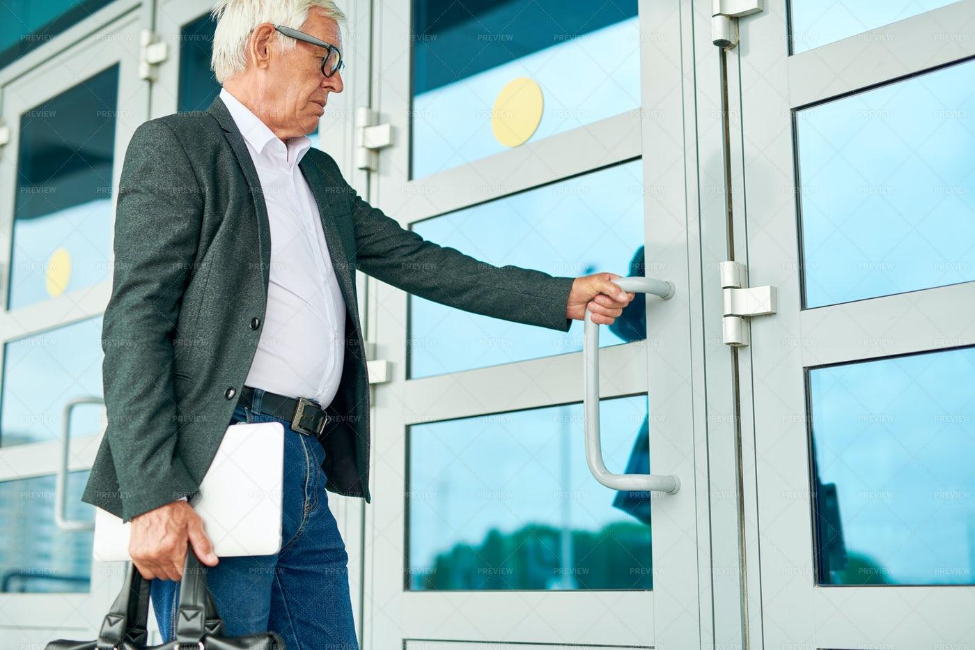 Senior Businessman Entering...: Stock Photos