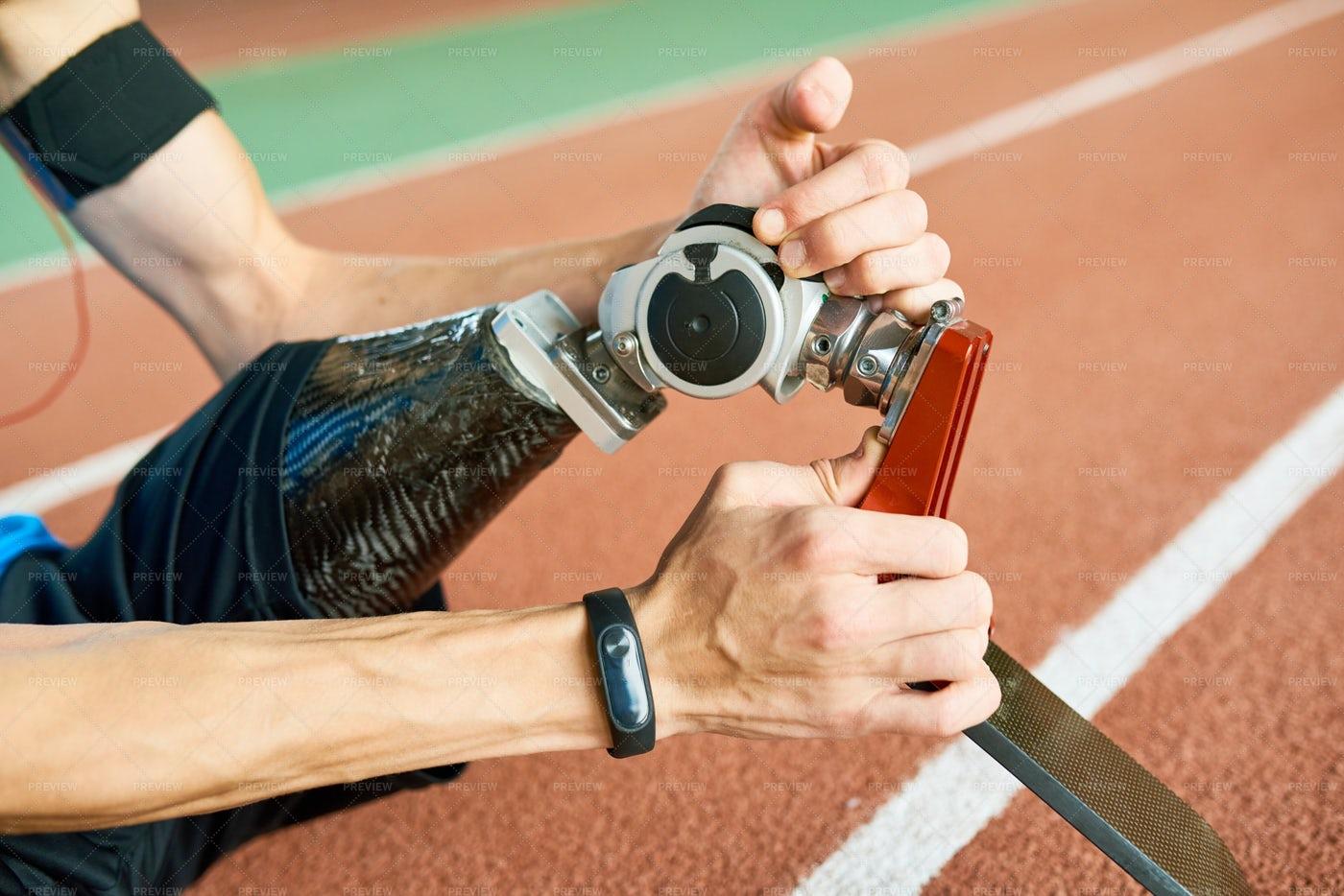 Disabled Sportsman Fixing...: Stock Photos