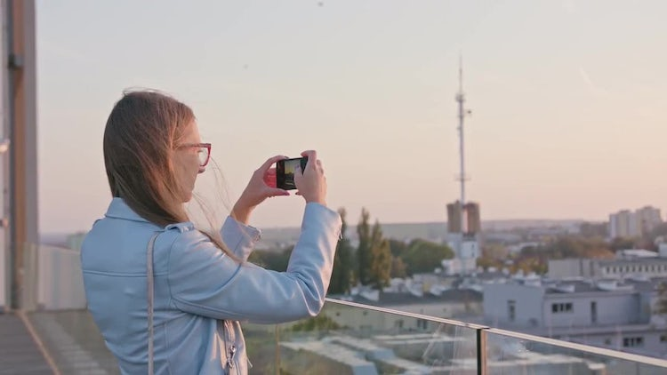 Young Lady Taking Photos: Stock Video