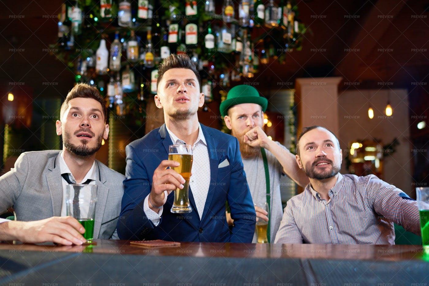 Men Wrapped Up In Watching Rugby...: Stock Photos