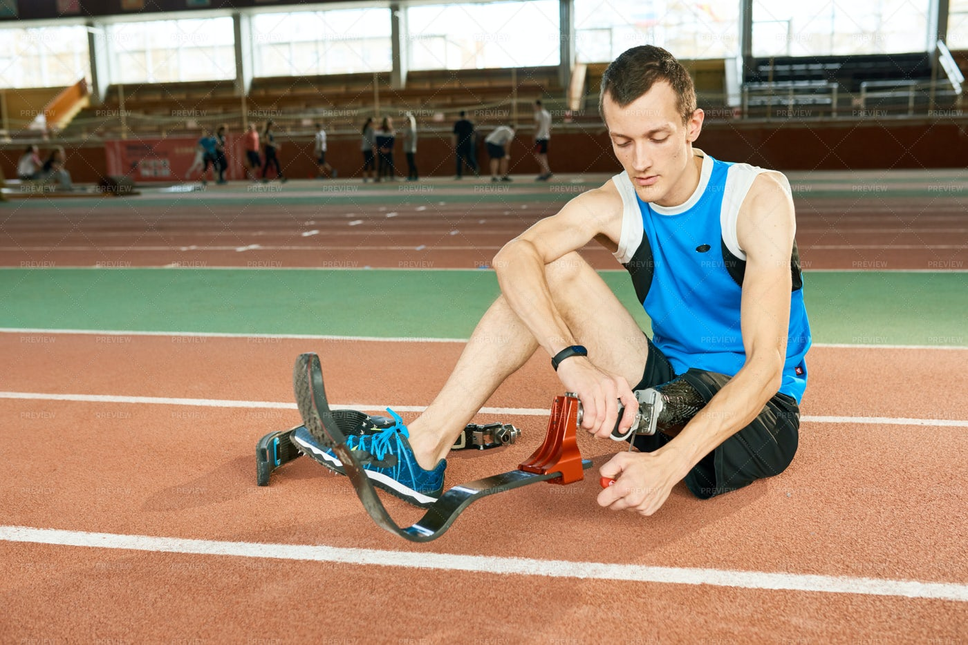 Handicapped Sportsman Putting On ...: Stock Photos