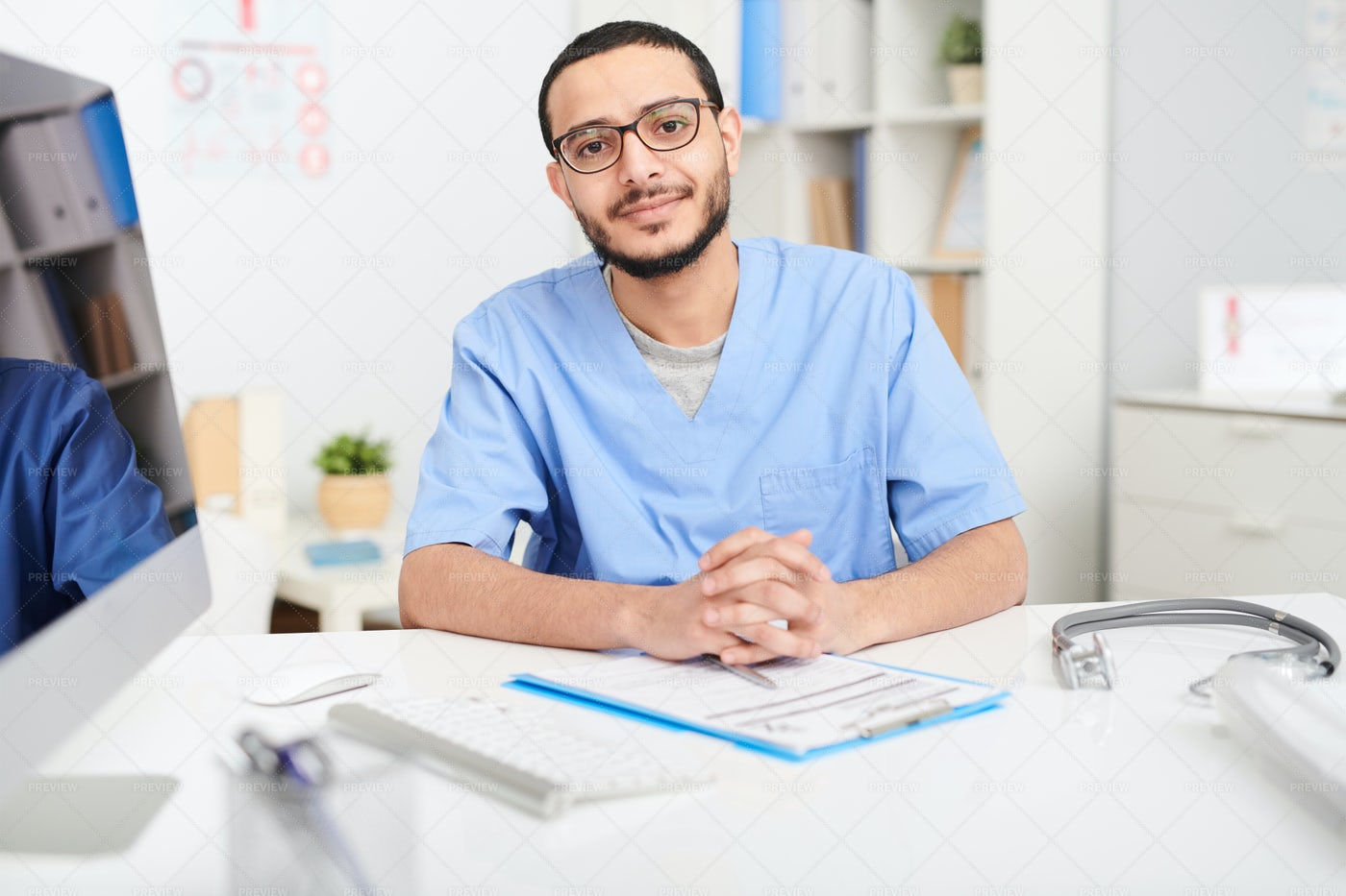 Middle-Eastern Doctor Posing At...: Stock Photos