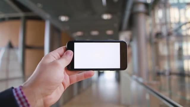 A Hand Holding A Phone: Stock Video