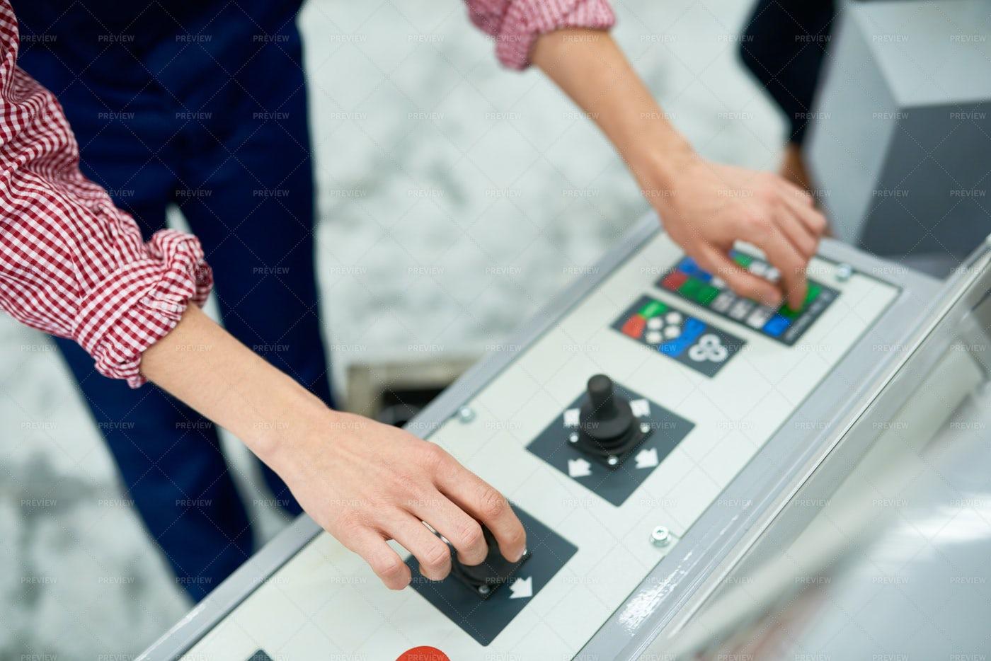 Woman Operating Machine At Factory: Stock Photos