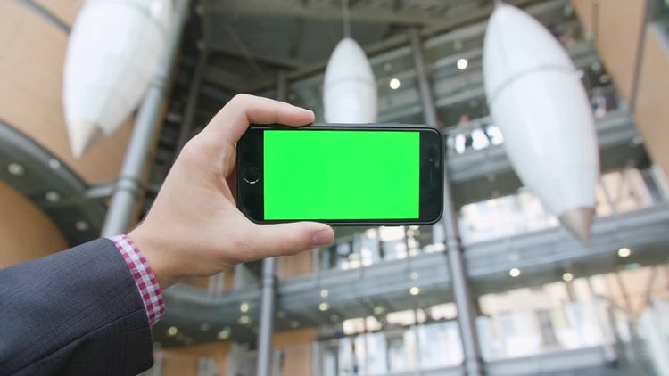 Hand Holding Phone With Green Screen: Stock Video