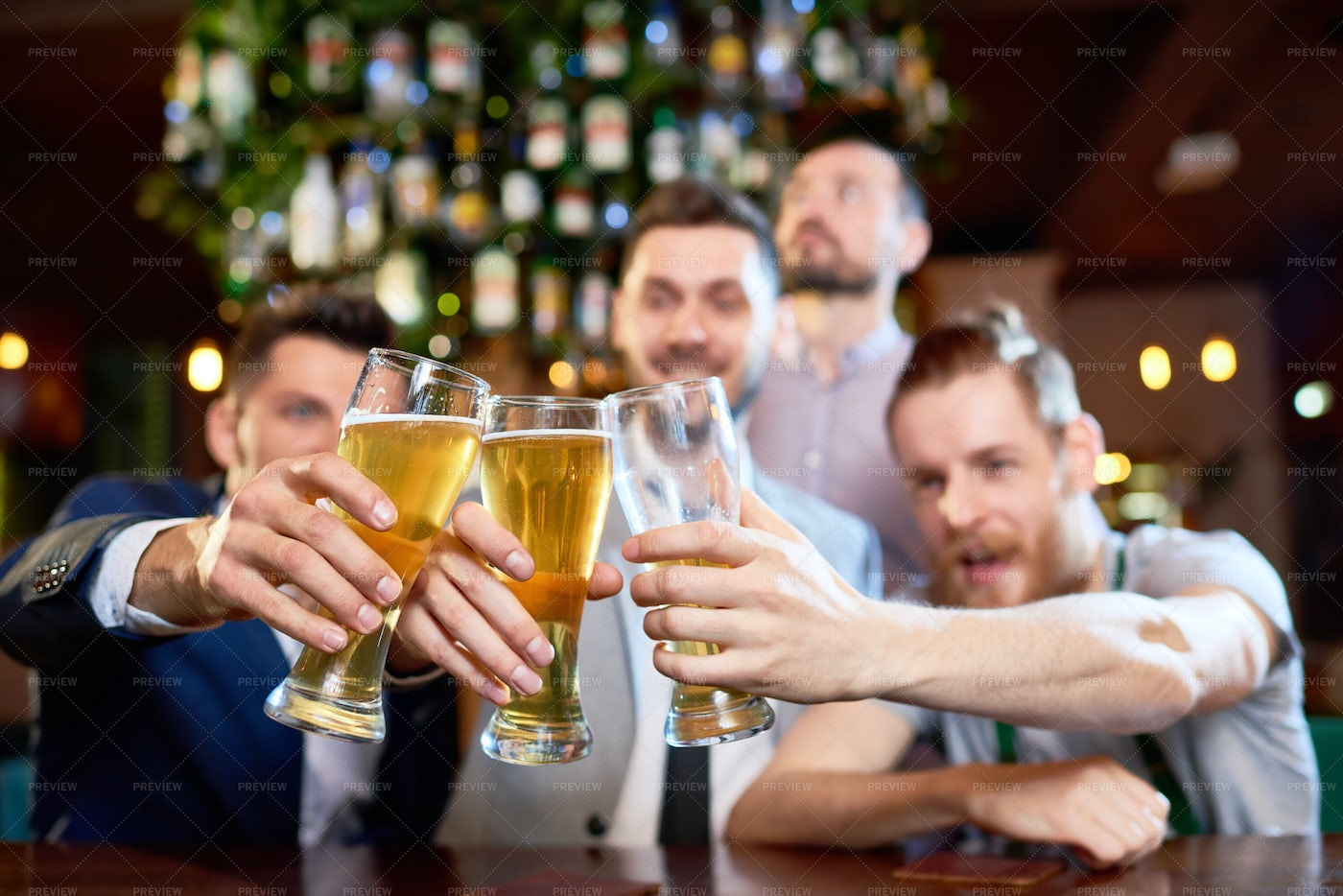 Clinking Beer Glasses Together: Stock Photos