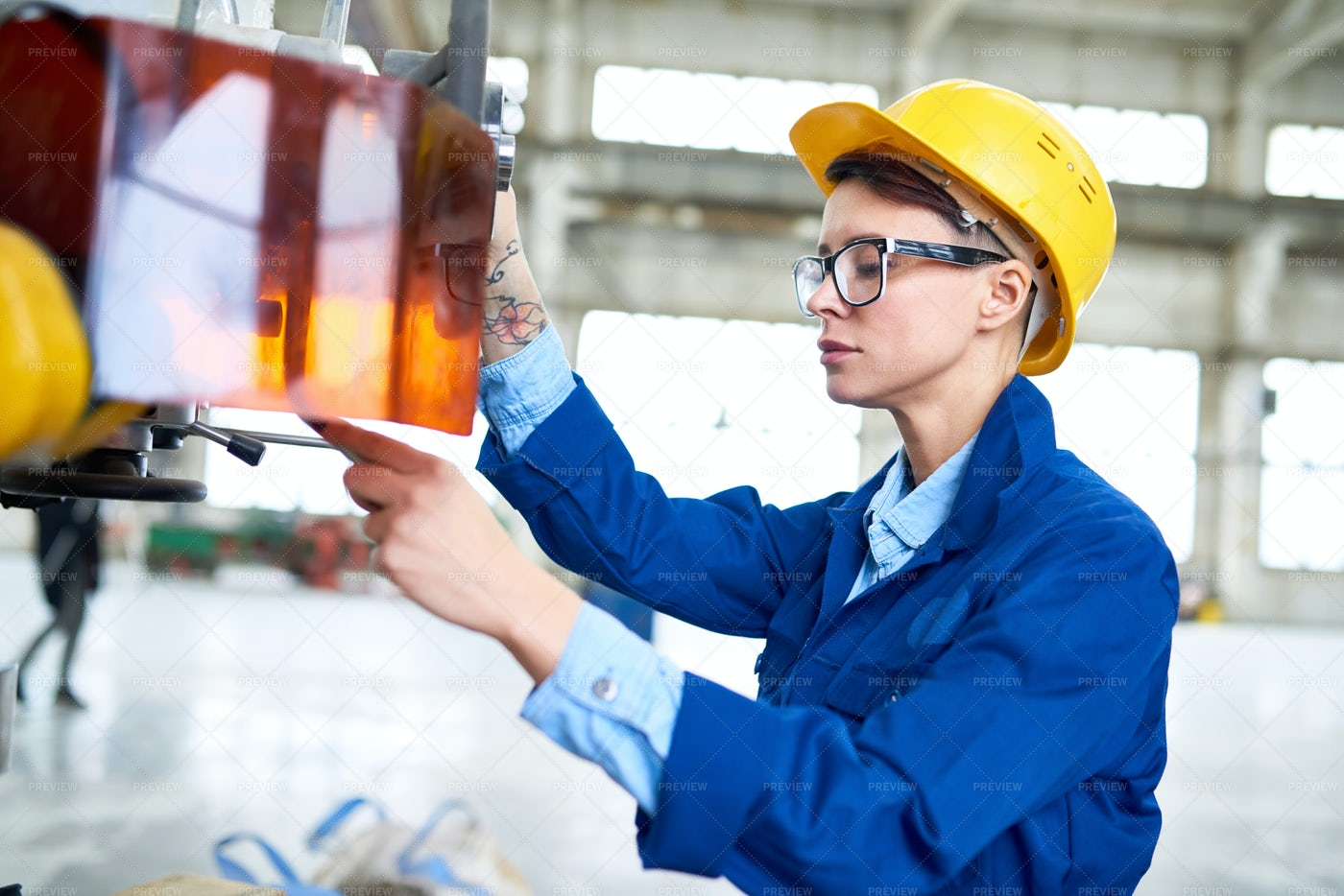 Modern Woman Working At Factory: Stock Photos