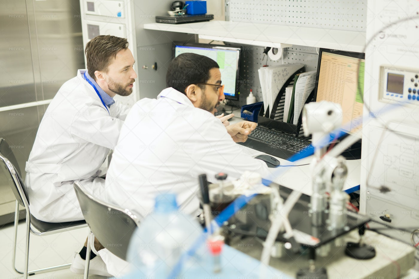 Busy Technicians Viewing Data In...: Stock Photos