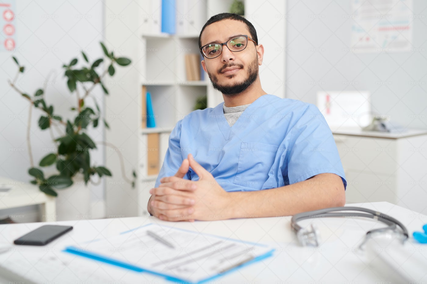 Confident Middle-Eastern Doctor...: Stock Photos
