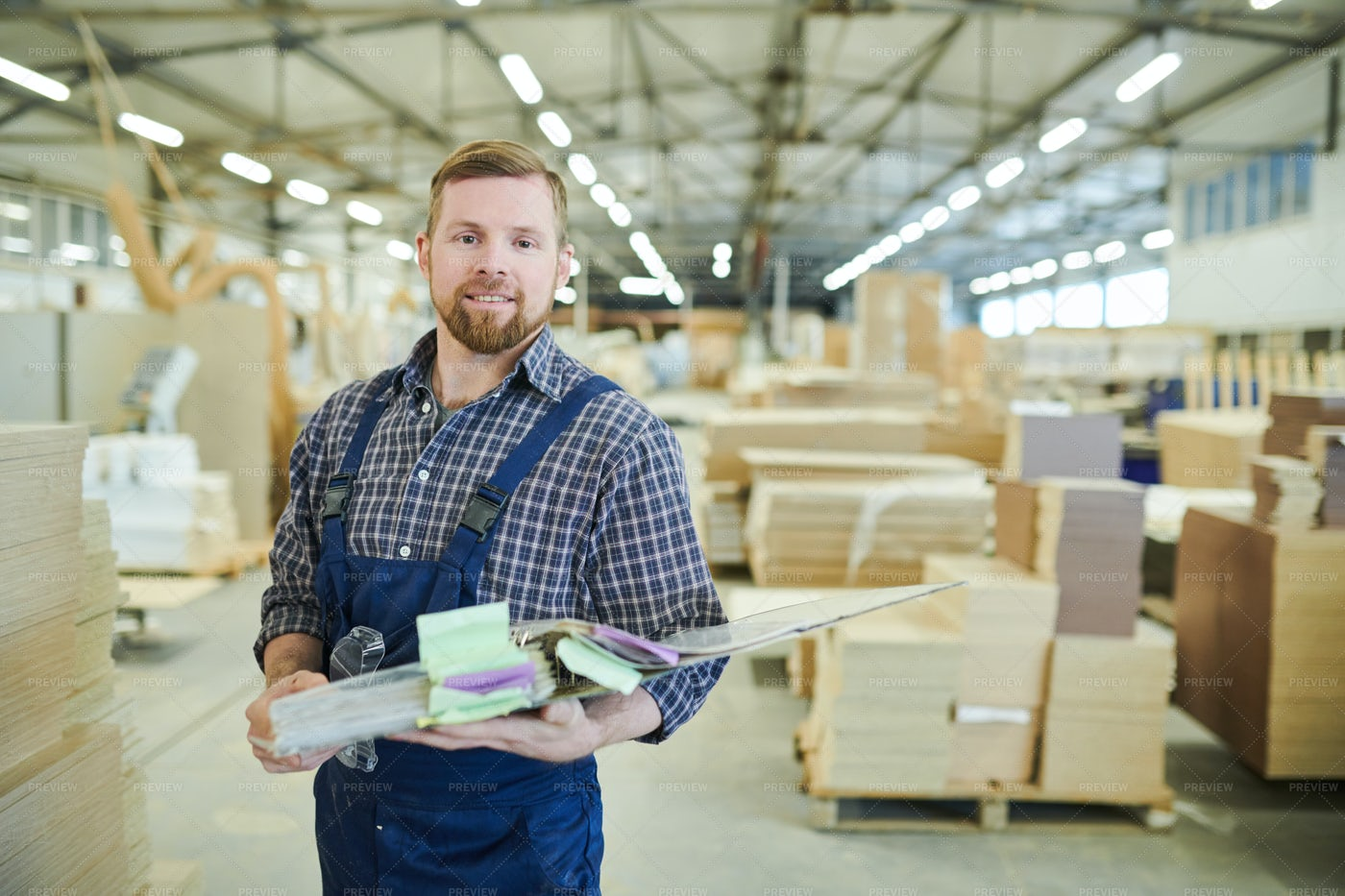 Smiling Factory Inspector Holding...: Stock Photos