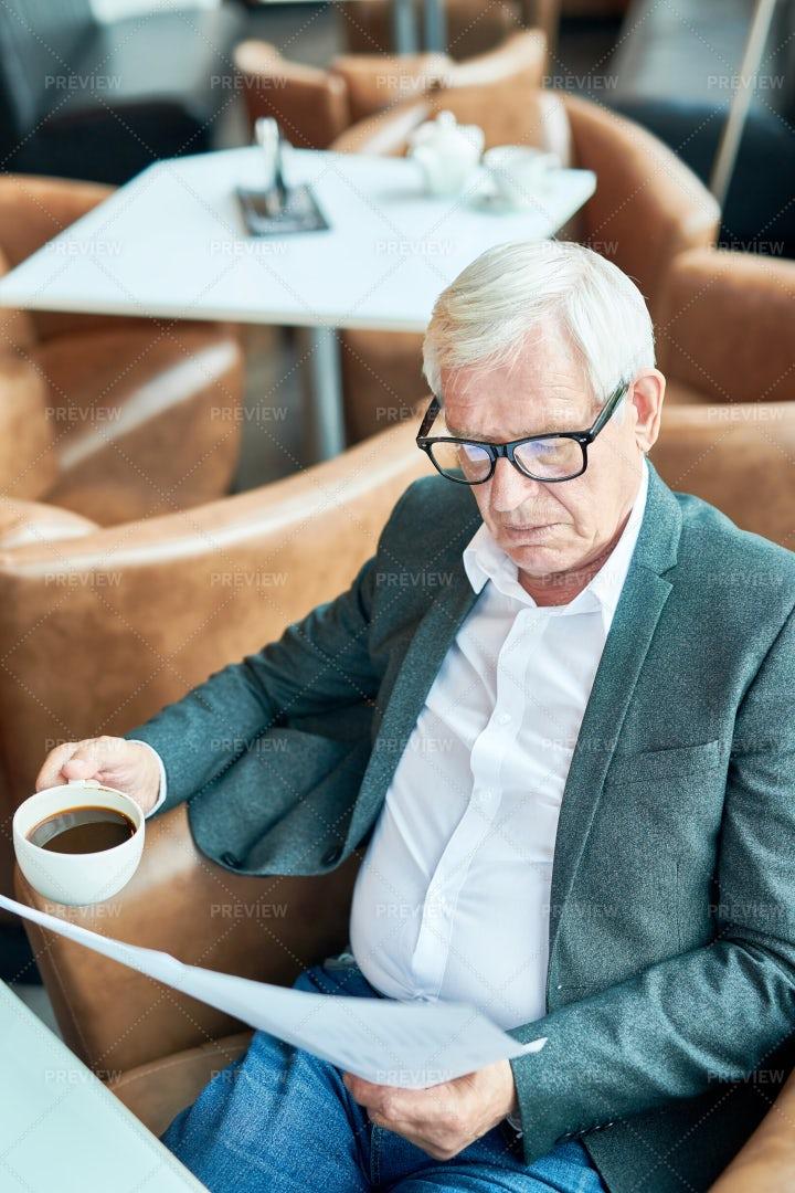 Modern Senior Businessman Working...: Stock Photos
