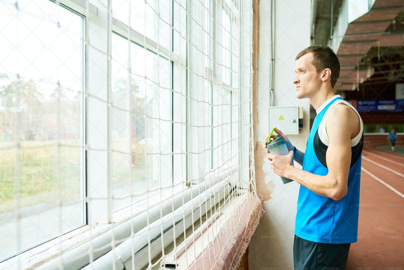 Pensive Sportsman By Window: Stock Photos