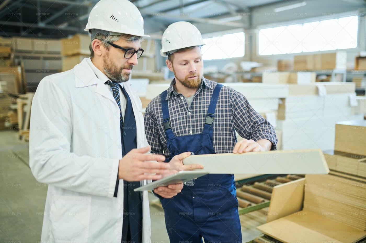 Quality Control Expert Examining...: Stock Photos