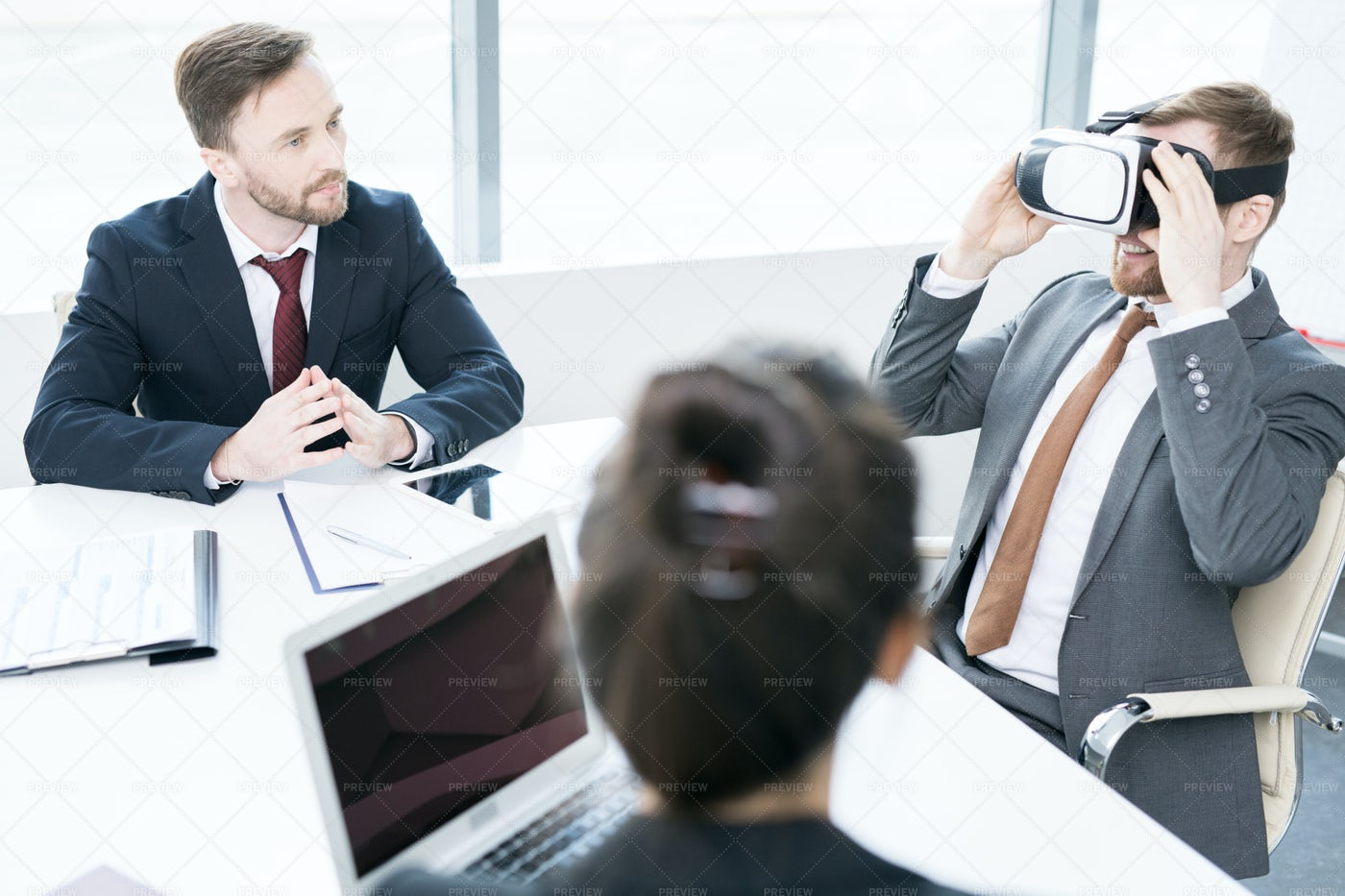 Businessman Using VR In Meeting: Stock Photos