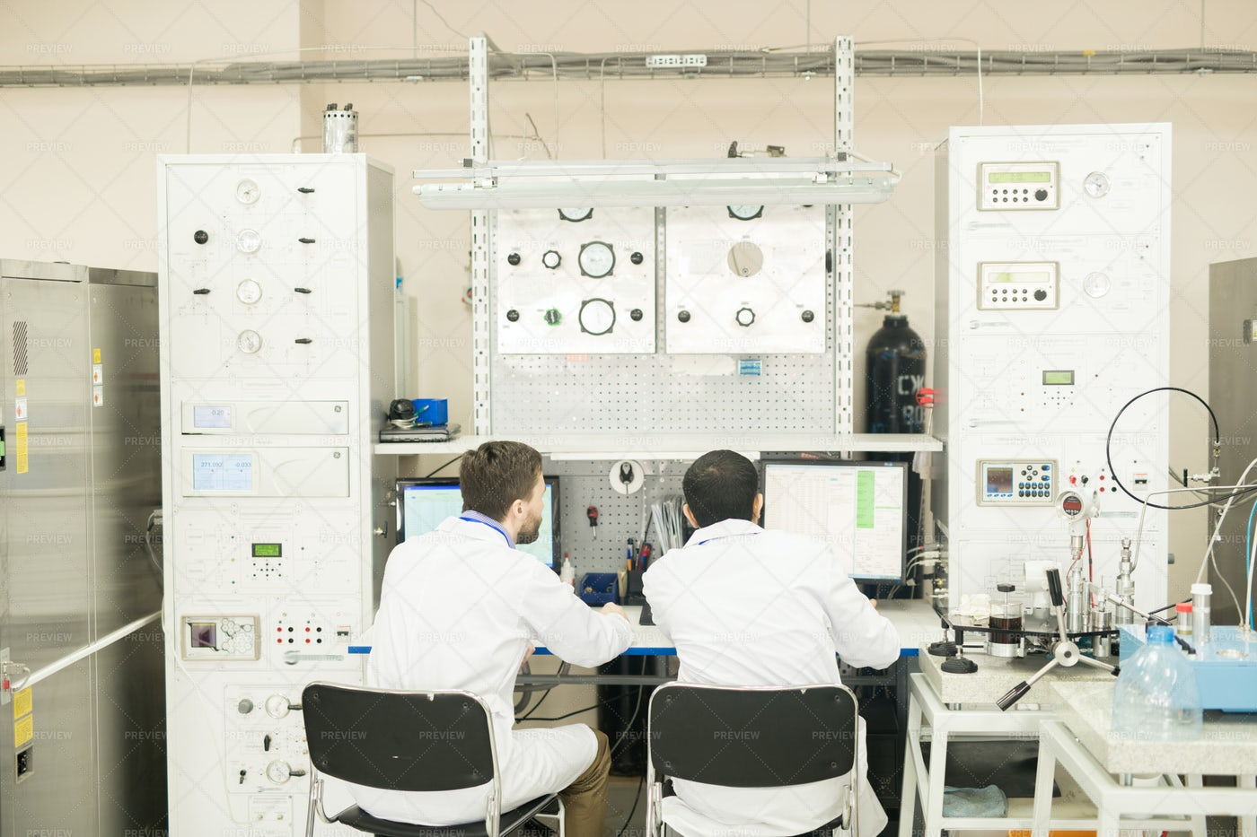 Engineers Working With Computer...: Stock Photos