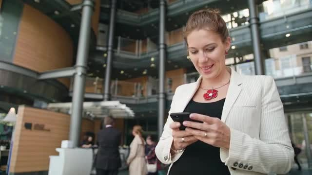 Woman Using A Smartphone: Stock Video