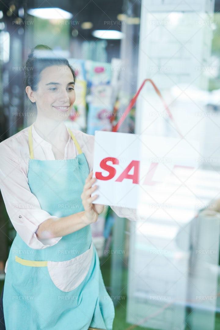 Shopkeeper Hanging Sign: Stock Photos