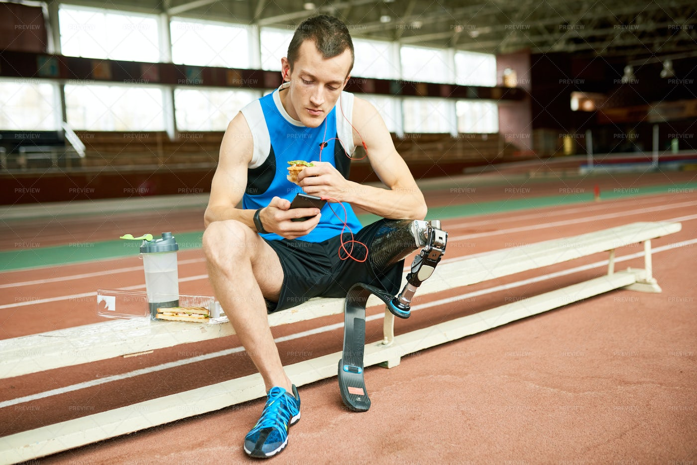 Handicapped Sportsman Eating...: Stock Photos