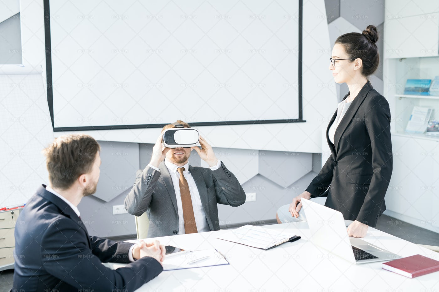 Businessman Enjoying VR Headset In...: Stock Photos