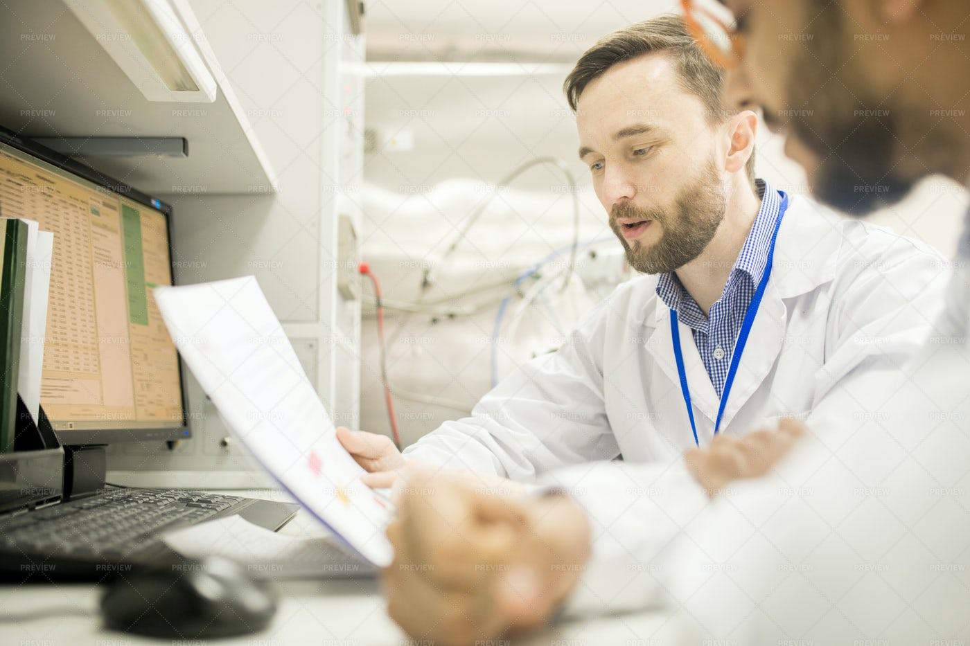 Confident Lab Engineer Explaining...: Stock Photos