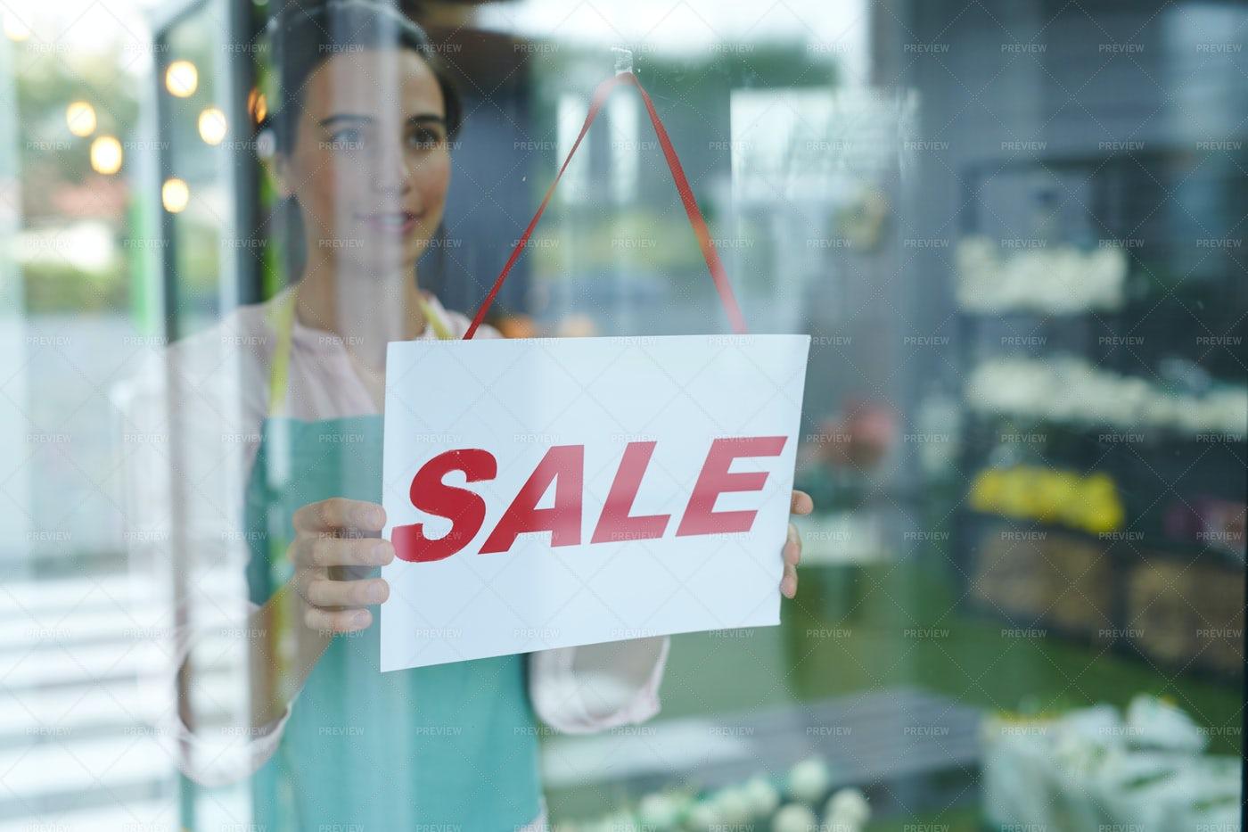 SALE Sign On Shop Window: Stock Photos