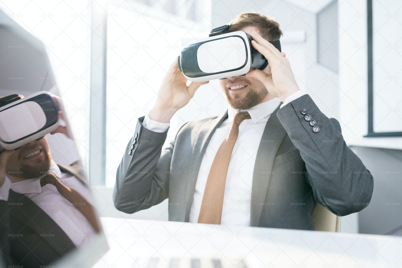 Businessman Using VR At Work: Stock Photos