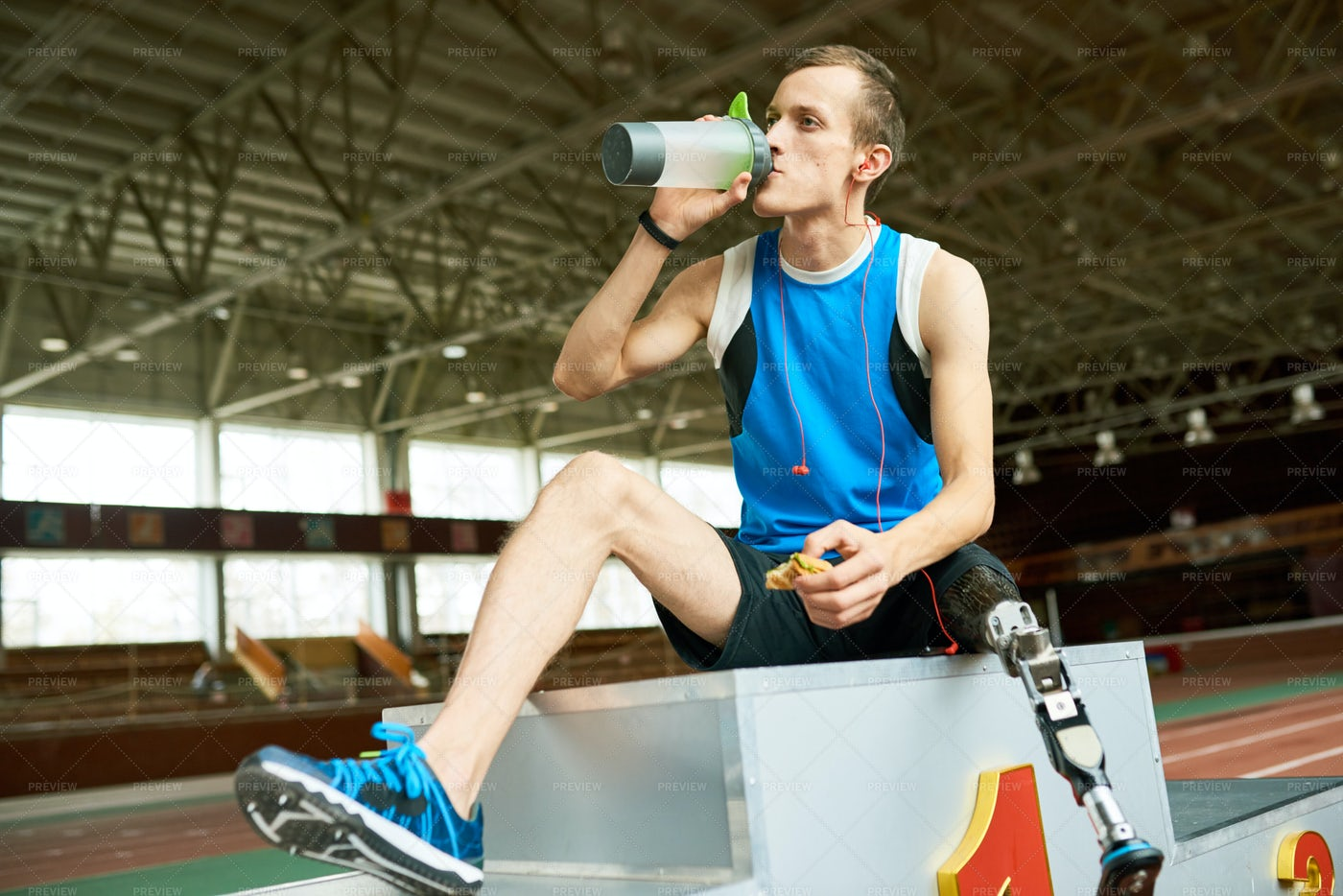 Handicapped Sportsman Eating On...: Stock Photos