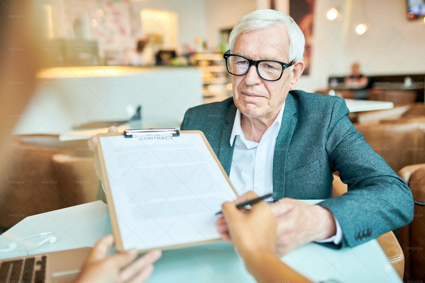 Senior Manager Signing Contract...: Stock Photos