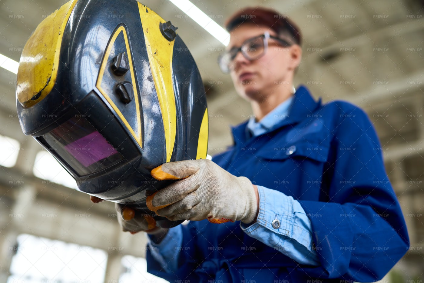 Female Welder At Industrial Plant: Stock Photos