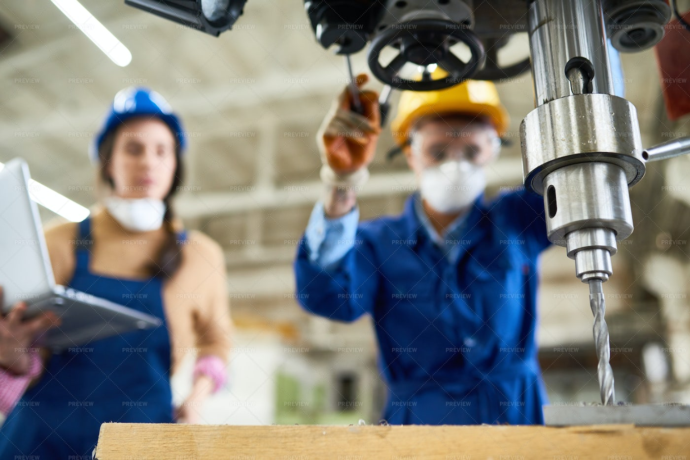 Female Factory Workers Operating...: Stock Photos