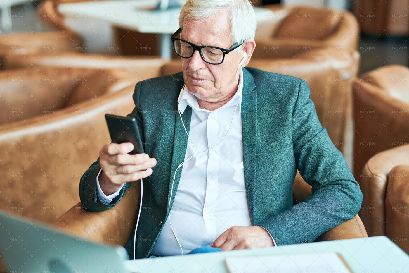 Contemporary Senior Man Using...: Stock Photos