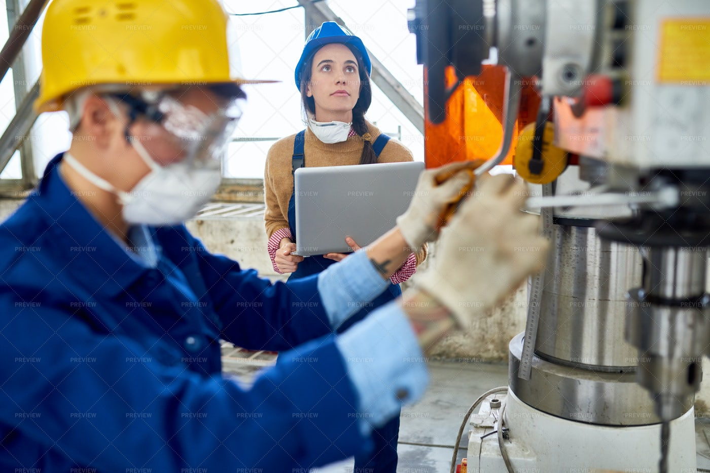 Female Engineer Working At Factory: Stock Photos