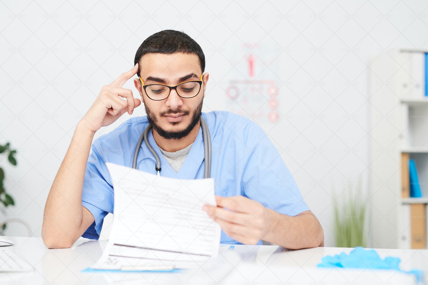 Pensive Middle-Eastern Doctor...: Stock Photos