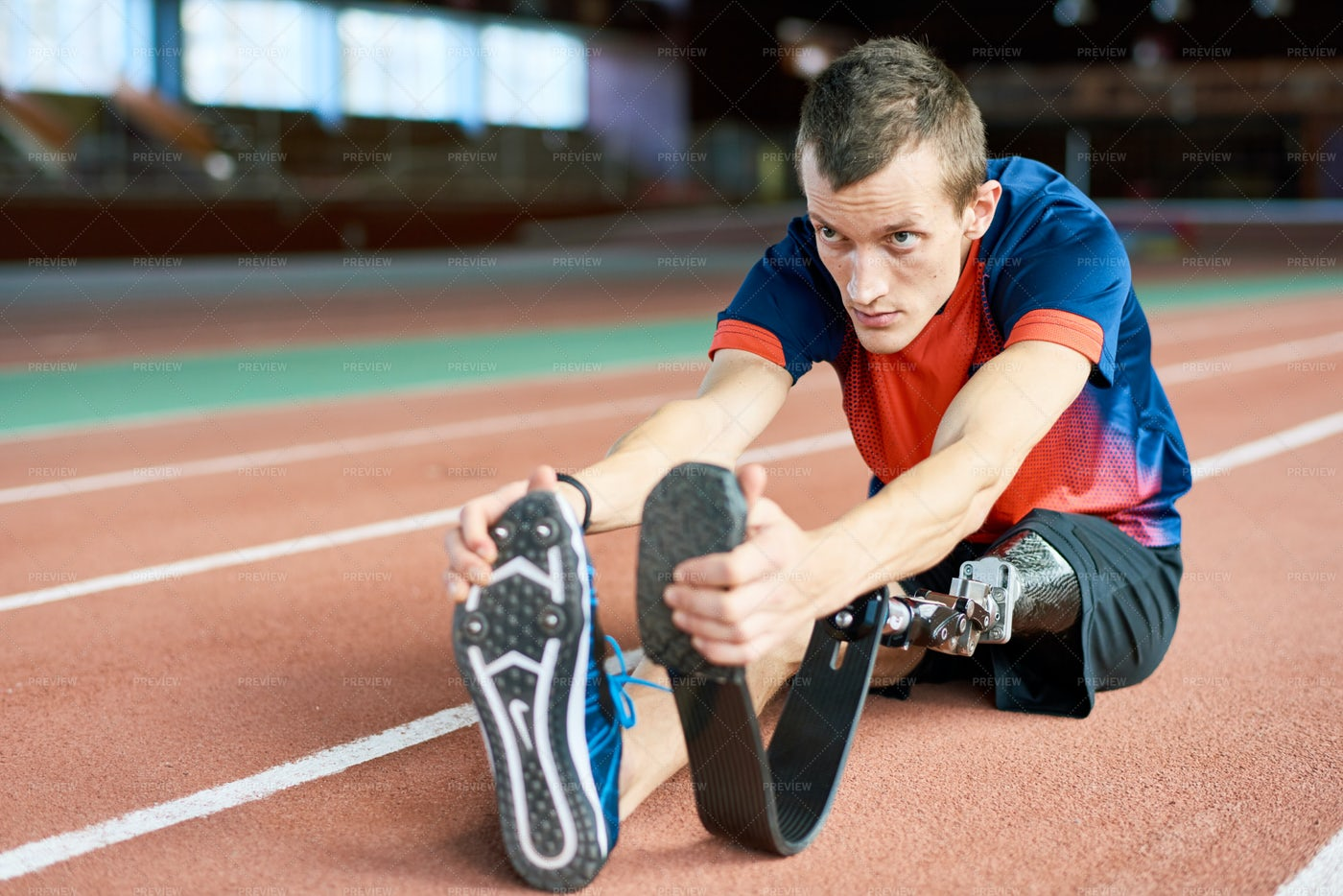 Handicapped Sportsman Stretching In...: Stock Photos