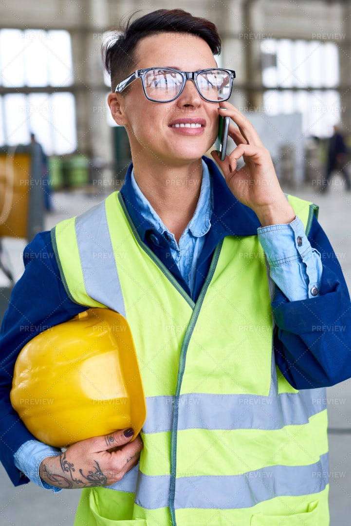 Modern Woman Speaking By Phone At...: Stock Photos