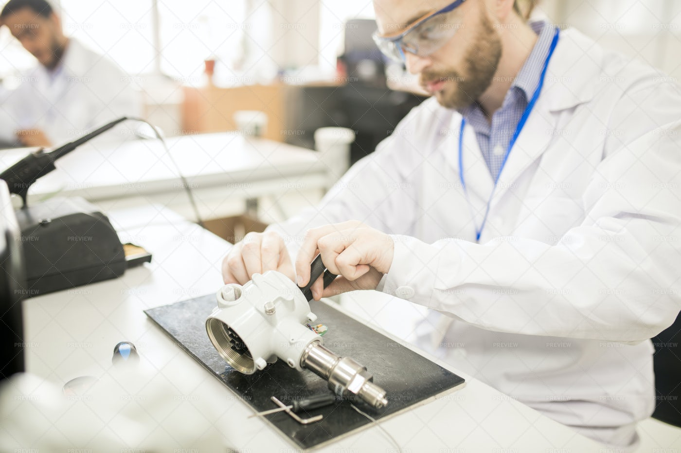 Concentrated Technician Finding Out...: Stock Photos