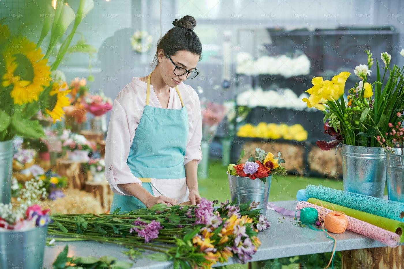 Young Woman Arranging Flowers: Stock Photos