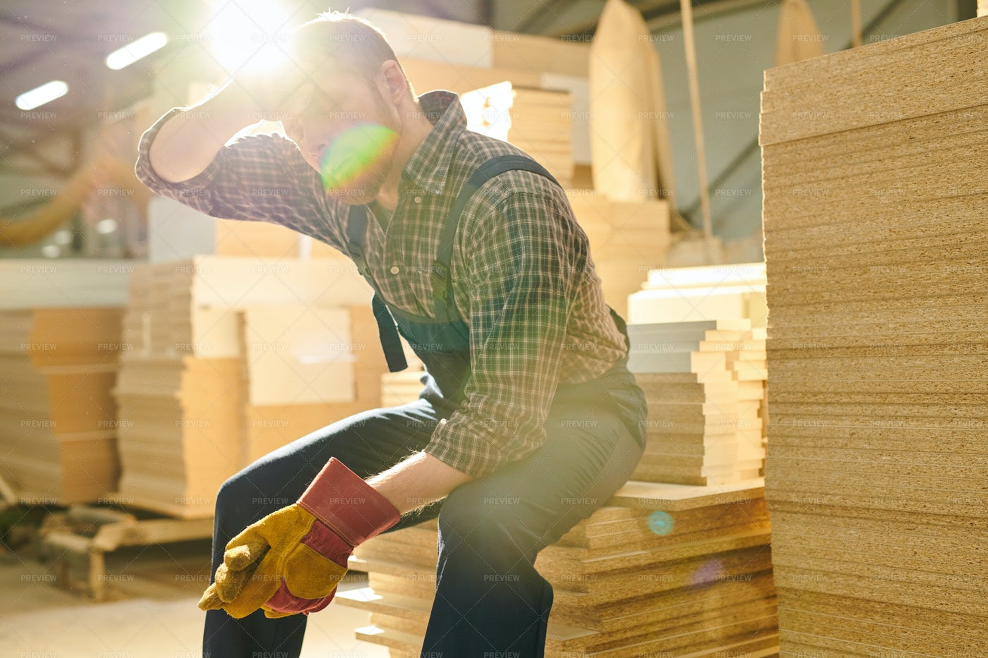 Exhausted Worker Wiping Sweat From...: Stock Photos