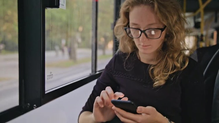 Woman Using A Phone On The Bus: Stock Video